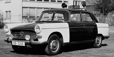 Peugeot-404-Polizei-Einsatzfahrzeug in
